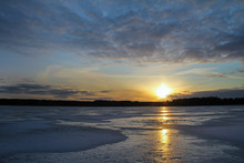 Winter Landscape With Beautiful Frozen Lake At Sunset.
