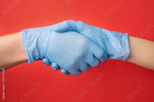 Leinwand Poster Handshake in rubber medical gloves
