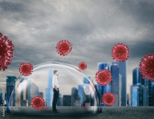Businessman safely inside a shield dome that protects him from virus Canvas Print