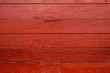 canvas print picture - Background of vintage barn siding painted red with peeling paint and nail heads visible