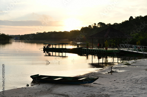 Valokuvatapetti boat and pier at dawn on one of the tributaries of the Amazon in Brazil