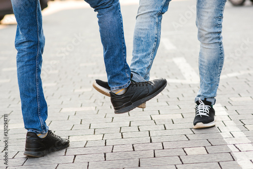 Cuadros en Lienzo Low section of men greeting each other with feet
