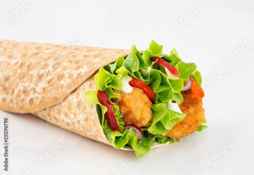 Fototapeta Wrap with fried chicken and vegetables isolated on a white background obraz