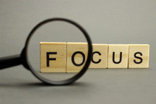 The Word Focus Is Made Of Wood...