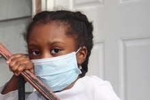 Kid Wearing Surgical Mask Outs...