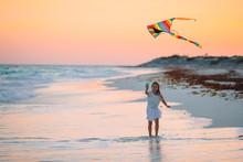 Little Girl Flying A Kite On T...