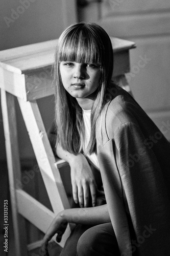 Fototapety, obrazy: Portrait of a beautiful thoughtful  teenage girl of the European race. Studio photo shoot. Black and white photo. Photo with blurred background.