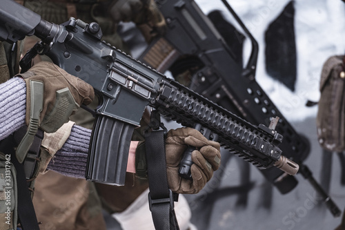 The military with rifles are preparing for the assault. Wallpaper Mural