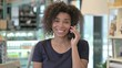 Portrait of Young African Woman Talking on Smartphone