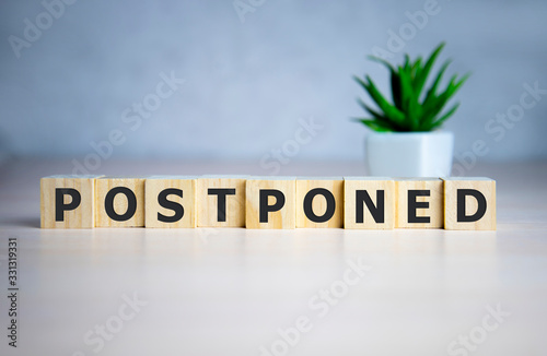 Postponed - words from wooden blocks with letters, postponed concept, top view b Canvas Print