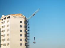 High-rise Crane Lifts The Load.