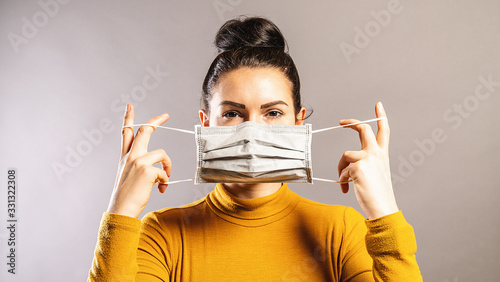 Obraz Woman wearing an anti virus protection mask to prevent others from corona COVID-19 and SARS cov 2 infection - fototapety do salonu