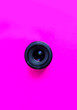 canvas print picture - A professional camera lens in a pink background