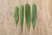 Four Green Bambou Leaf On Wood...