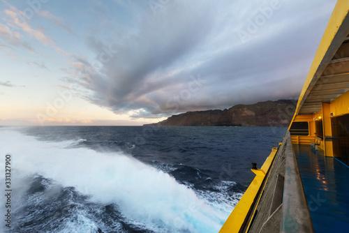 Clouds at dusk at sea from cruise ship railing . Canvas Print