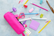 Pencil Case And School Stationery On Color Background