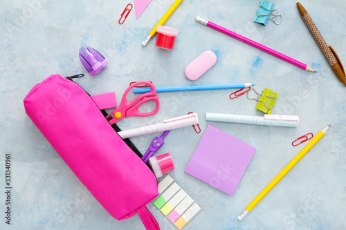 Pencil case and school stationery on color background Wallpaper Mural