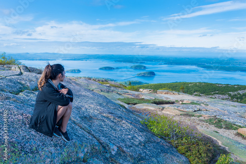 Woman enjoying the beautiful view of small islands seen from Cadillac mountain i Wallpaper Mural