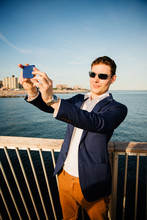 Young Man Taking A Selfie On The Beach