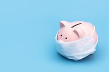 Pink Piggy Bank Stands On A Bl...