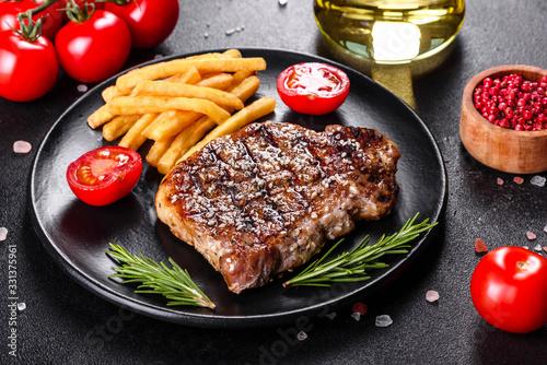 Fototapeta Ribeye steak with potatoes, onions and cherry tomatoes obraz