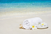 White Spa Towel And Flowers On...