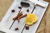 Fototapeta Dmuchawce - ingredients for tea and desserts .cinnamon lemon anise