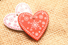 Two Wooden Hearts On Burlap Cloth Background