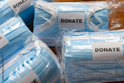 Photo 5 packs of medical face masks for donating