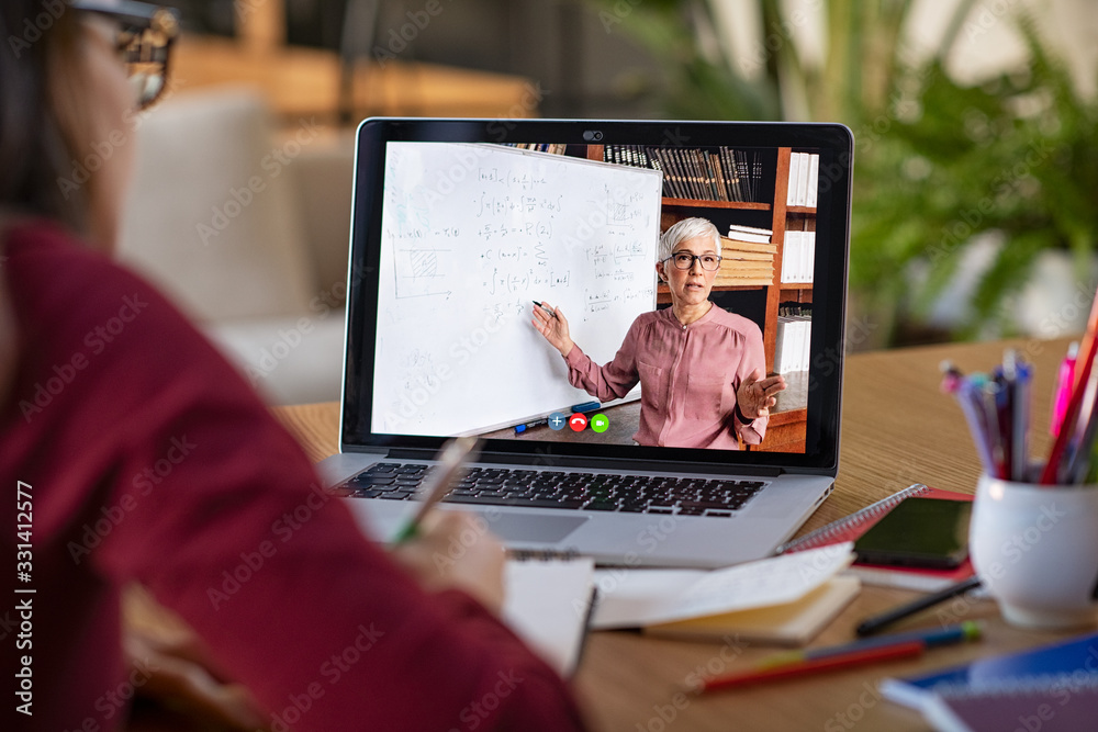 Fototapeta Studying with video online lesson at home