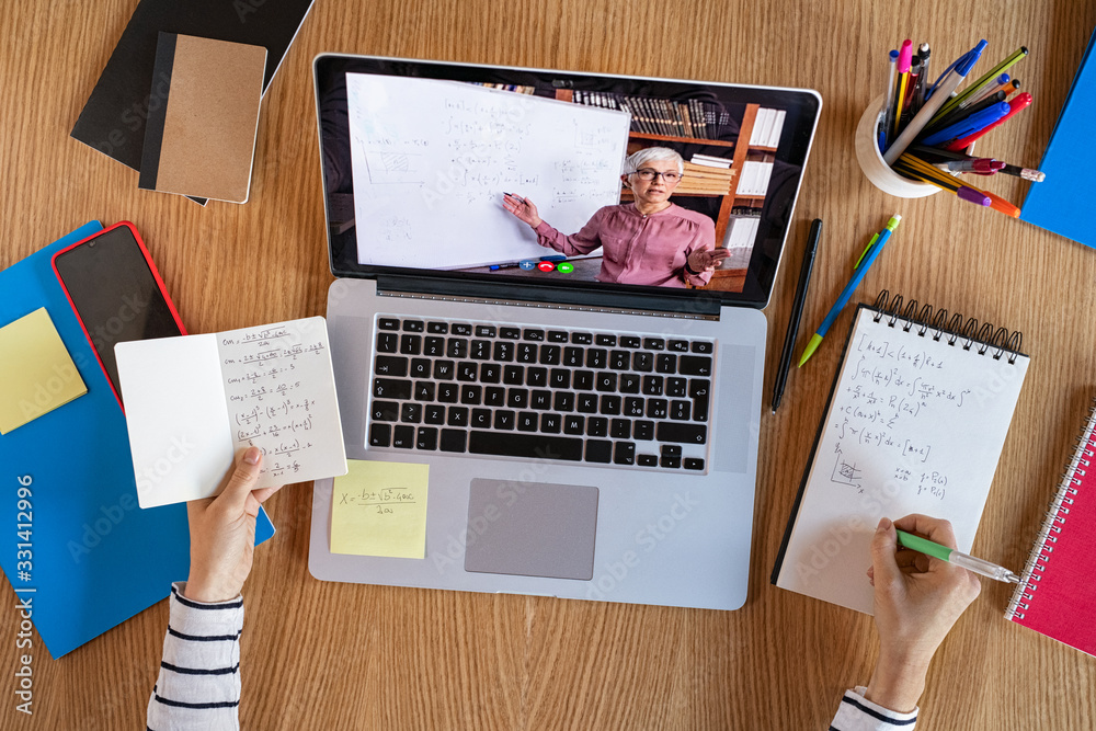 Fototapeta Student learning at home with online lesson