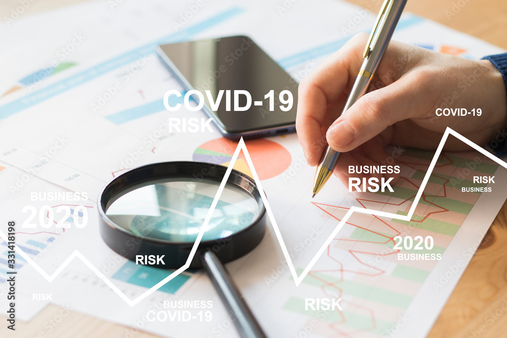 Fototapeta Businessman works with documents a business risk chart due to a coronovirus pandemic. Business risks covid-19