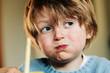 canvas print picture - Junge beim Essen mit vollem Mund