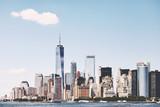 Fototapeta Nowy Jork - New York City skyline on a beautiful sunny day, color toning applied, USA.