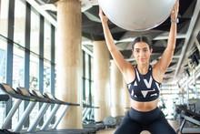 Fit Athletic Woman Doing Squat...