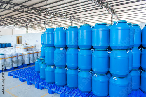 Fotomural Blue Plastic barrels contain in factory
