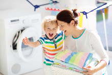 Family In Laundry Room With Wa...