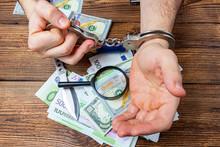 Handcuffed Hands On A Money Ba...