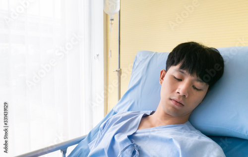 Asian patient young man sleep and rest from recovery body by intravenous drip eq Wallpaper Mural