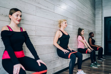 Women Training With Fitness El...