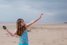 A Windswept Teenage Girl Pract...