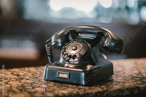 Altes Telefon auf Marmortisch Canvas Print