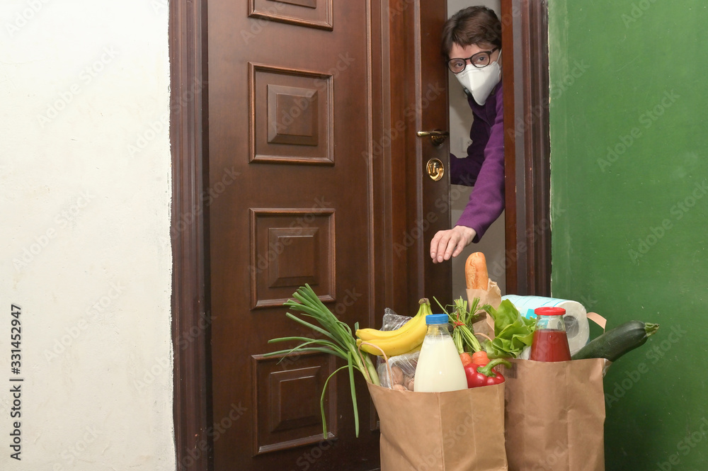 Fototapeta Delivering Food To A Self-isolate Woman or Quarantine
