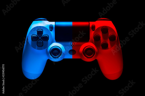 White video game joystick gamepad in blue and red neon lights isolated on black