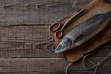 Sea Bass Fish On The Wooden Ru...