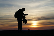 Silhouette Of A Man And His Ju...