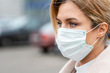 Portrait Of Young Woman Wearing Surgical Mask