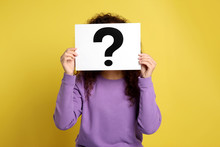 Woman With Question Mark Sign On Yellow Background
