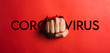 canvas print picture - Human hand tearing red paper with the word coronavirus, concept in the fight against coronavirus