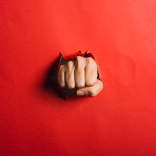 Human Hand Tearing Red Paper With The Word Coronavirus, Concept In The Fight Against Coronavirus